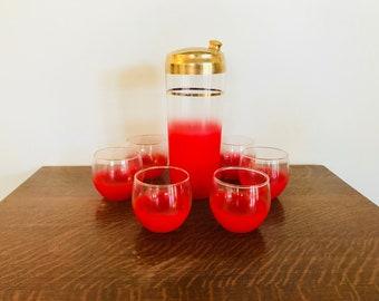 Red Blendo shaker and 6 glasses