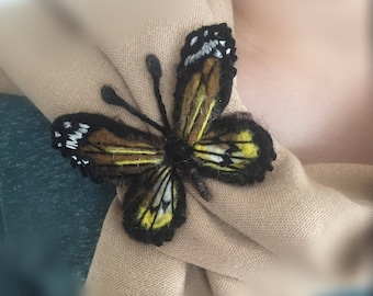 A butterfly scarf accessory