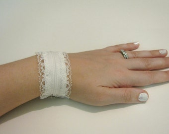White lace adjustable zipper cuff with peekaboo lace inside
