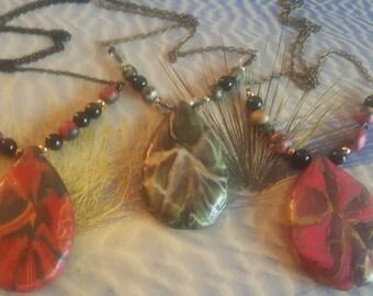 Bolt pattern teardrop pendant necklaces