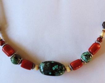 Necklace gemstones: turquoise, coral (imitation), ivory imitation, metal beads and cotton.