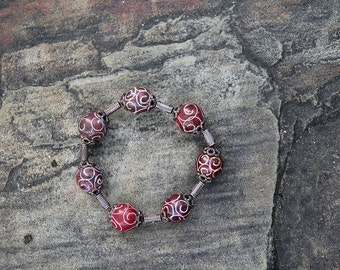 Red Swirly Ball Bracelet