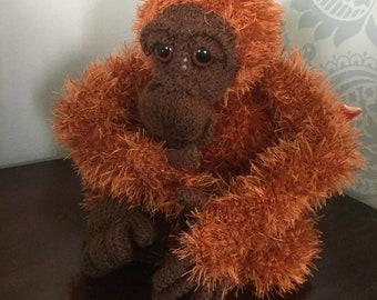 Orangutan knitted tea cosy