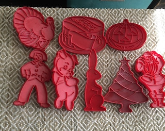 Red Tupperware holiday cookie cutters