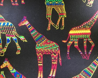 Colorful giraffes in black cotton fabric.  Hi-Fashion Fabrics. Quilting Cotton Fabrics.  Choose your cut.