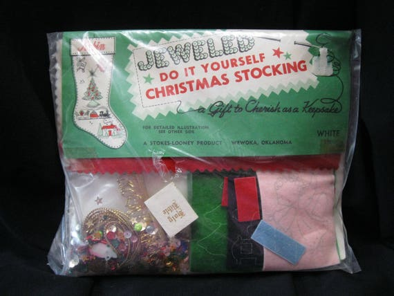 Jeweled do it yourself christmas stocking kit circa 1950s by jeweled do it yourself christmas stocking kit circa 1950s by stokes looney white felt stocking felt appliques sequins braid charms from solutioingenieria Images