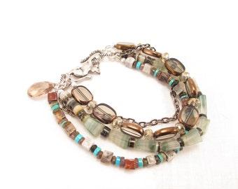 Bracelet-sundance style-fluorit-glass-heishe-smoky quartz-cat closure four strands-wrist ornament   multi colored bangle contemporary