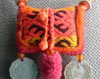 Textile necklace/pendant in warm tones. Handmade jewelry.