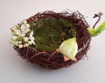Support ring bearer nest with button and branch