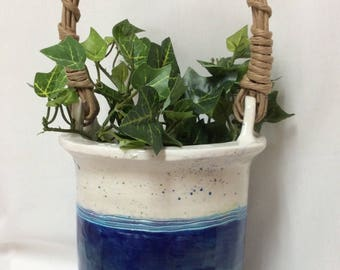 Vase with cord handle