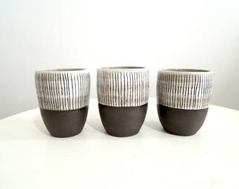 Striped brown and white ceramic cup, teacup