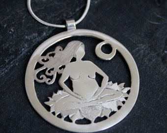 Creation Goddess Pendant sitting in the lotus flower in the light of the Moon