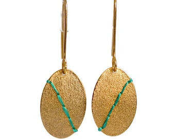 Gold plated Silver oval disc earrings stitched with embroidery thread