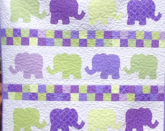 Handmade elephants on parade baby quilt.