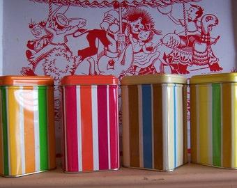 four little striped tin boxes