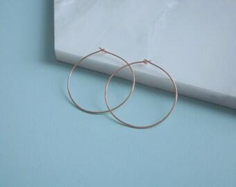 Solid 9ct rose gold hoop earrings. Minimal everyday gold hoop earrings.