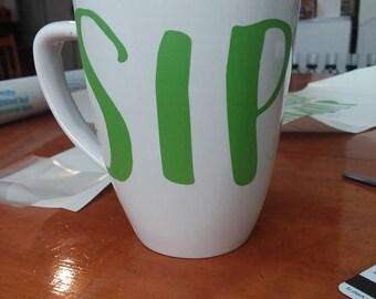 Sip mug.