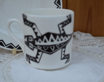 Repeat Repeat Stoke England black and white lizard coffee can matching saucer/ships worldwide from UK