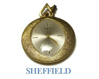 FREE SHIPPING Sheffield watch pendant - Swiss Made, shock resistant brushed gold wind up necklace in working condition