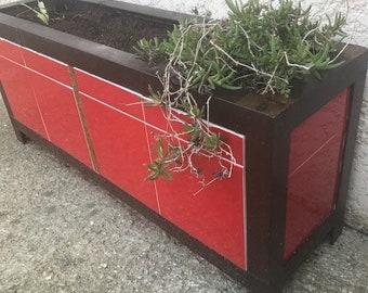 Steel and ceramic planter