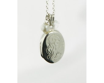 Silver oval locket with birthstone necklace
