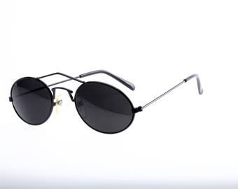 Cool sloping oval shades with peaked top bar and designed nose bridge, thin enameled metal black frames, dark green lenses, genuine 90s NOS