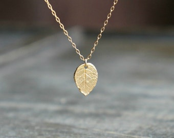 Small gold pendant etsy gold leaf necklace small realistic gold leaf pendant on a gold filled chain simple everyday jewelry gift for nature girl aloadofball Choice Image