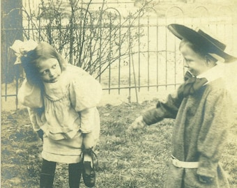 Antique RPPC Boy Girl Playing Outside Magic Carpet Brother Sister Sepia Photo Photograph Postcard