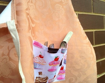 Child's full kitchen or craft apron, waterproof, with large front pocket.