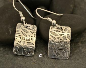 sterling silver textured earrings.  choose a or c.  Each earring 3/4 x 1/2 in.