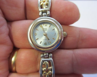 "Vintage ""  Faded Glory"" jewelry Ladies watch, silver and gold segment band and  white face used fair condition"