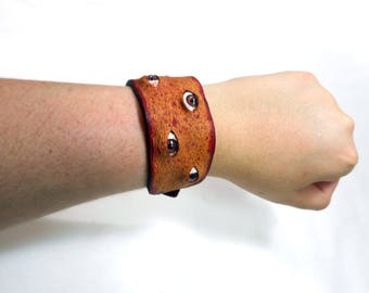 Bloody leather flesh cuff with eyeballs , real leather bracelet with acrylic brown eyes, splatter blood and gore, halloween horror, flayed