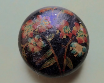 Wooden folk button, antique. It is hand painted and hand made, floral, convex with a black japanned base & a lacquered top.  c 1900.