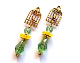 """Pair of handmade bird in golden cage pendants / Pearl mount """"teardrop"""" green and yellow glass, H = 48mm"""