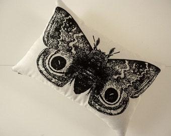 Giant Io Moth silk screened cotton canvas throw pillow 12x18 black sandstone