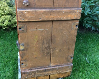 Unique upturned, upcycled old painted trunk transformed into stunning cabinet on castors with 1954 Earls Court motor show decoupage