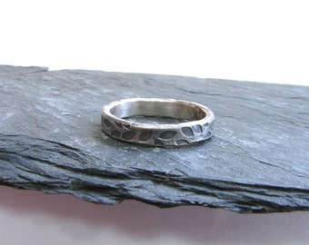 oxidised silver band textured with leaf pattern