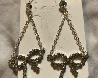 Set of bow silver dangle earrings w/ cubic zirconia around the bows