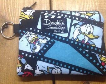 Donald Duck de pièce de monnaie pochette ~ Donald Duck Show