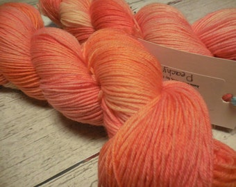 "Anglophile BFL fingering yarn in ""Peachy"" from AnniePurl"