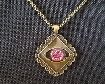 See inside Artisan resin pendant