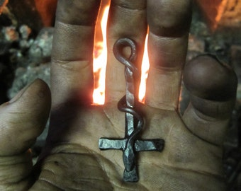 A hand forged inverted Cross & serpent pendant . Comes supplied with a high quality elk leather thread.