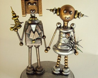 Robot Secret Agent Wedding Cake Topper with Ray Gun Bride Holding Hands Lilly Bouquet Wood Statues