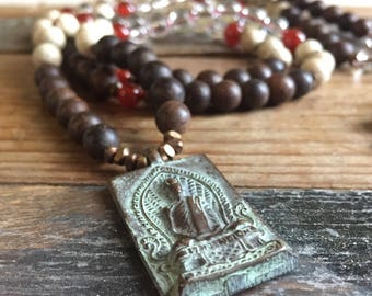 108 Bead Partially Handknotted   Spiritual Junkies   Agarwood, Lotus Seeds, Quartz Crystal, Carnelian + Thai Buddha Mala   Yoga + Meditation