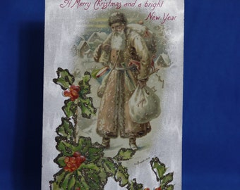 Vintage Santa Clause postcard  in brown suit with glitter