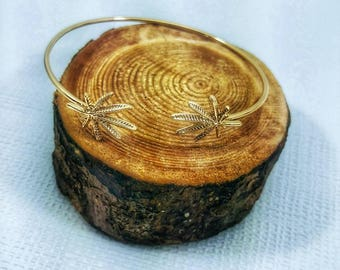 Cannabis Leaf Bangle Bracelet in Gold or Silver Tone.