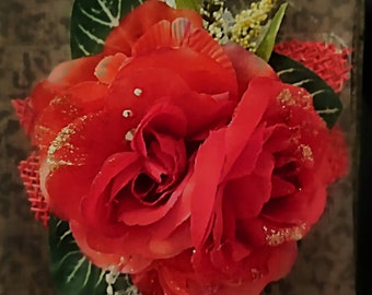 Red rose corsage with gold embelishments