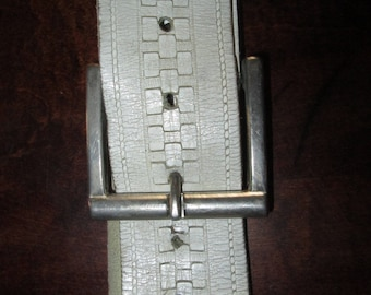 White leather belt 49 inches in length.