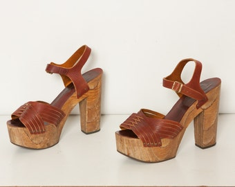 RESERVED / /   vintage 1970s wooden platform heels with leather straps women's size 10