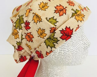 Ribbon Tie Back Scrub Cap scrub hat featuring a beige material with fall colored leaves and a matching ribbon